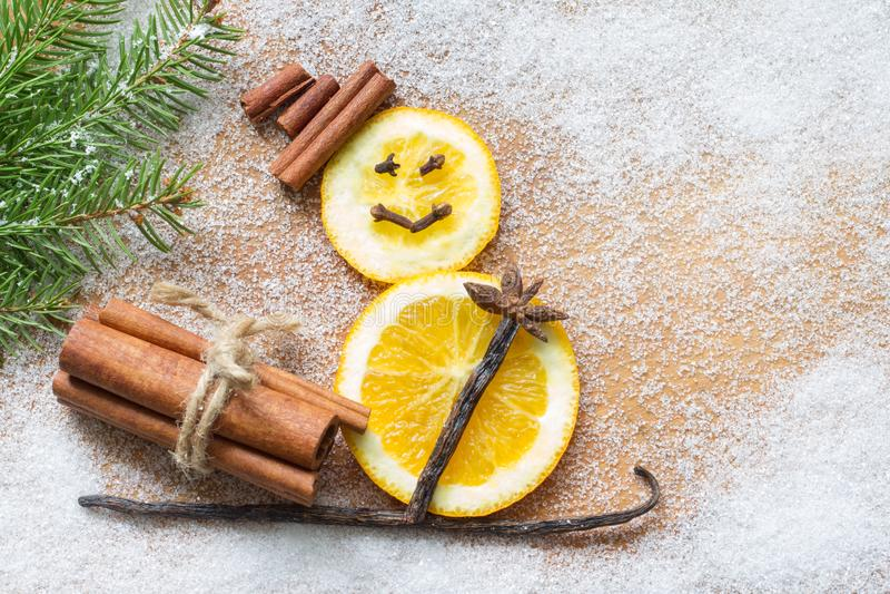 Christmas ornament orange abstract snowman on white sugar background. Closeup royalty free stock photos
