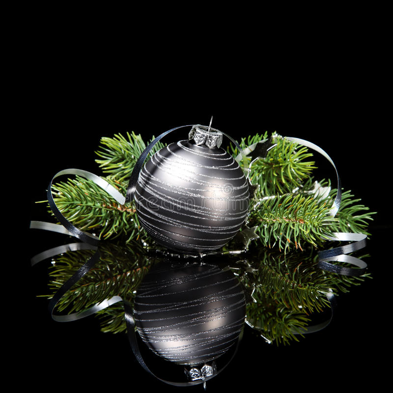 Download Christmas Ornament With Pine Tree Branches On A Bl Stock Images - Image: 34290354