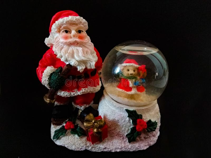 Christmas ornament of Santa Claus with a small snowball stock photos