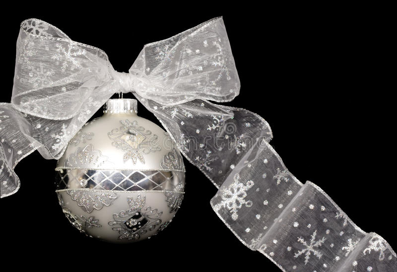 Christmas Ornament (Silver). Elegant silver Christmas ornament with bow on black background stock images