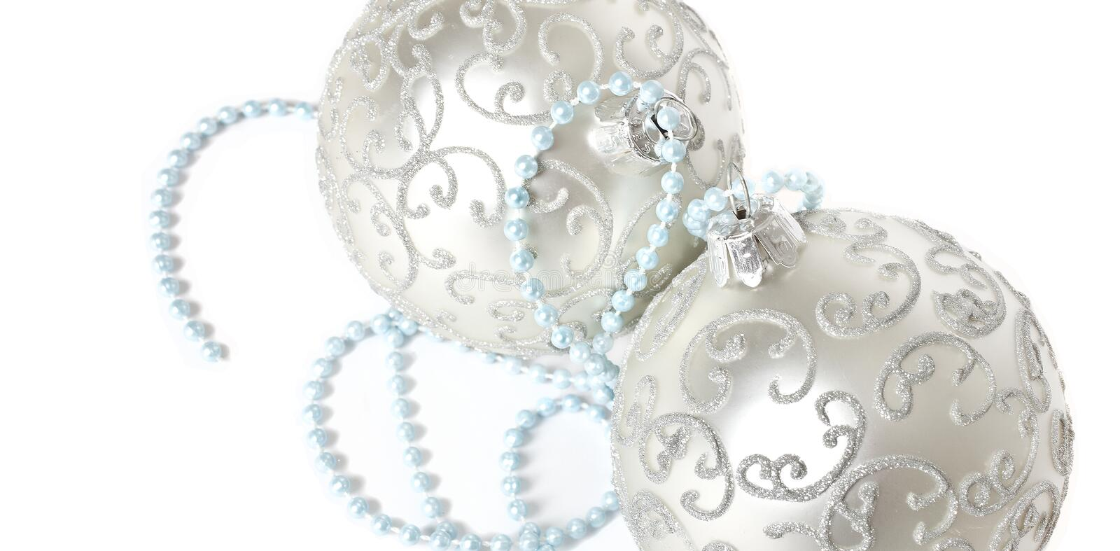 Christmas ornaments. Silver christmas ornaments with light blue pearls royalty free stock photos