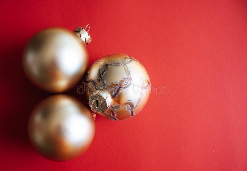Christmas ornaments background. Golden Christmas ornaments on red background. Christmas mood concept stock photos