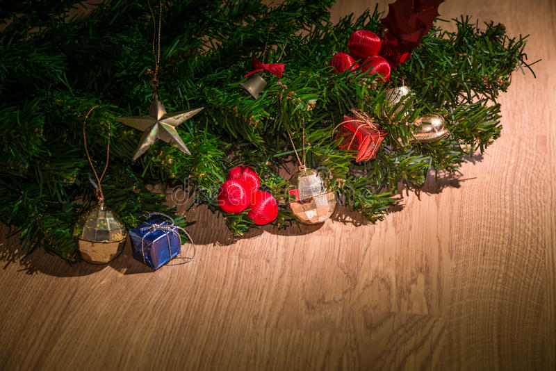 Christmas ornaments on Christmas tree. Christmas ornaments on the Christmas tree and wooden background stock photos