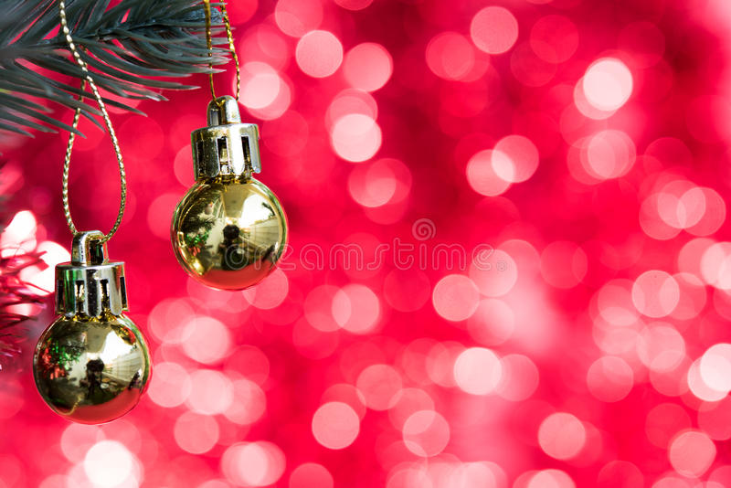 Christmas ornaments decorate on fir tree with gold bokeh royalty free stock photos