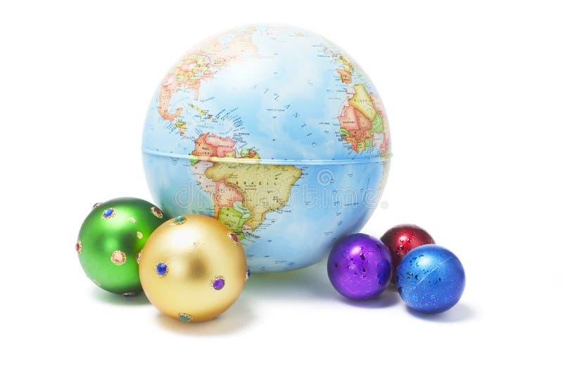 Christmas Ornaments and Globe royalty free stock photo
