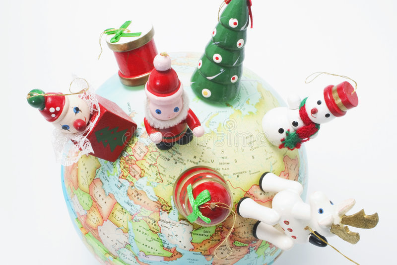 Christmas Ornaments on Globe stock photos