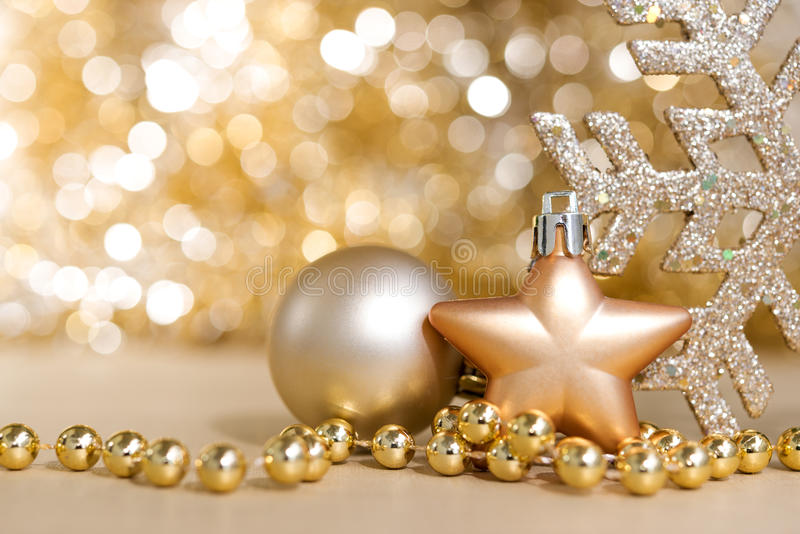 Christmas ornaments with gold circle bokeh light sparkle background. Christmas ornaments with abstract gold circle bokeh light sparkle background with copy space stock photos