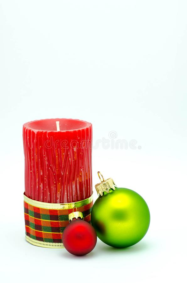 Christmas ornaments - red candle and red and gold ornaments stock photography