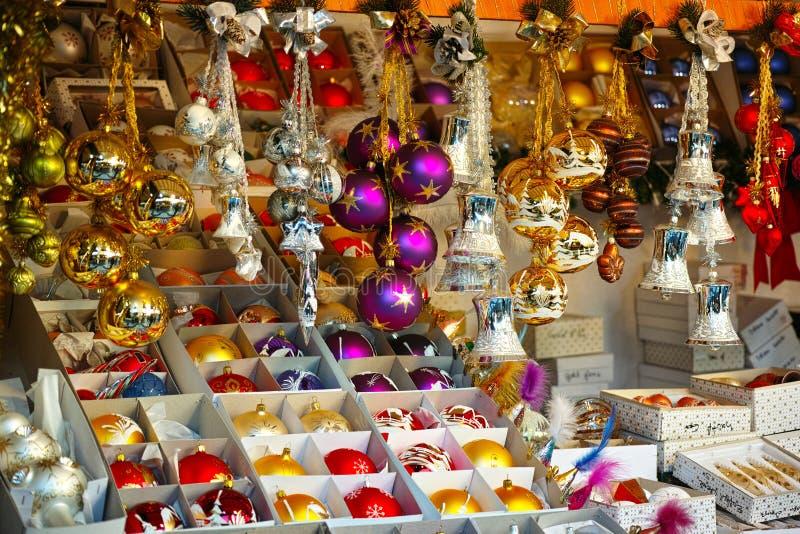 Christmas ornaments market stall. Showcase of Christmas ornaments offered for sale in a market stall. Displayed at a Christmas market in Germany stock image