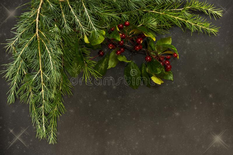 Christmas ornaments with small red berries, bright balls, red candles and a pine branch stock photos