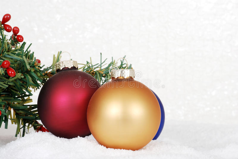 Christmas ornaments in snow royalty free stock photo