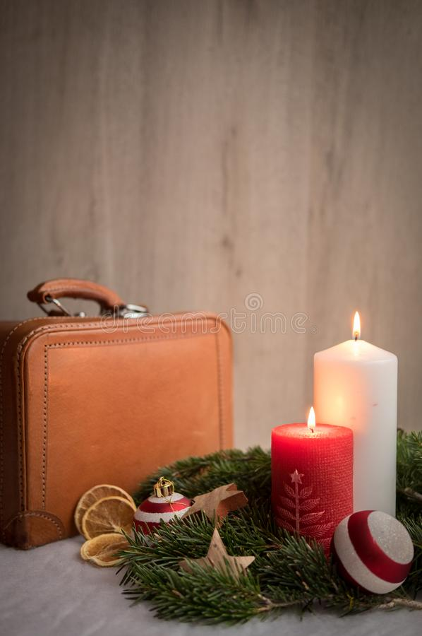 Christmas ornaments with snow, pine tree and candles stock photography