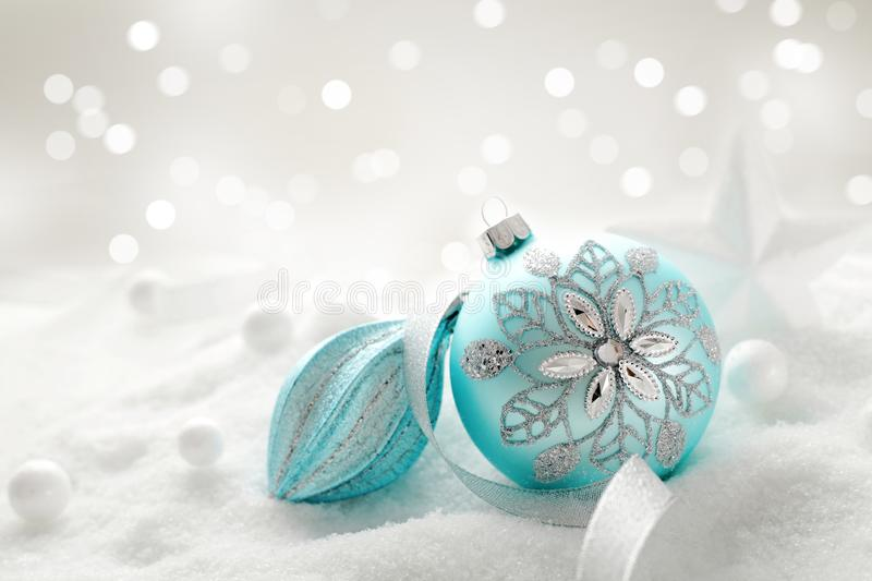 Christmas ornaments. And snow, seasonal decoration royalty free stock images