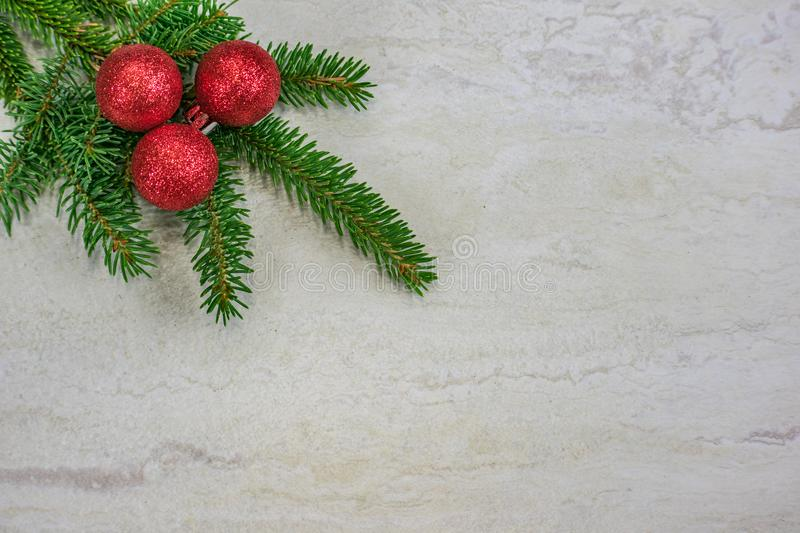 Christmas ornaments on a spruce bough with copy space stock photo