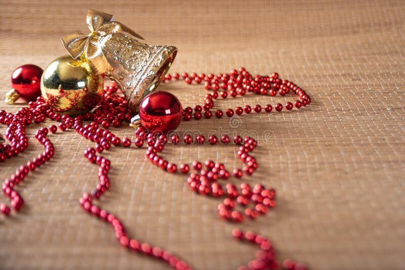 Christmas ornaments on a straw mat in a beautiful arrangement selective focus royalty free stock photos
