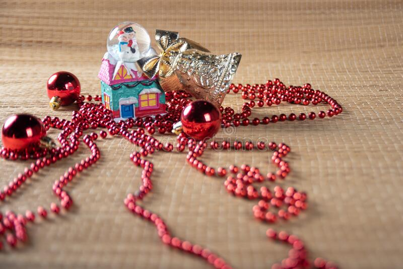 Christmas ornaments on a straw mat in a beautiful arrangement selective focus stock images