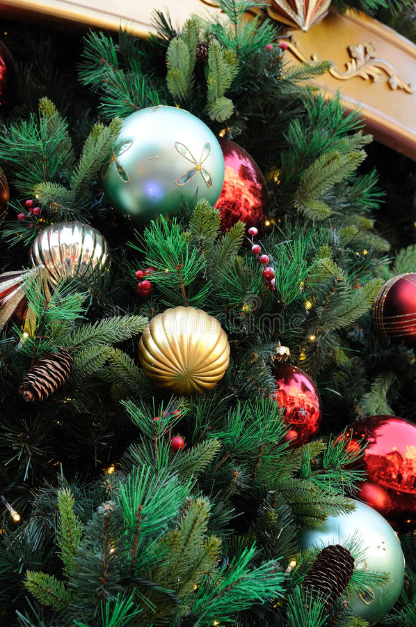 Christmas ornaments on tree stock images