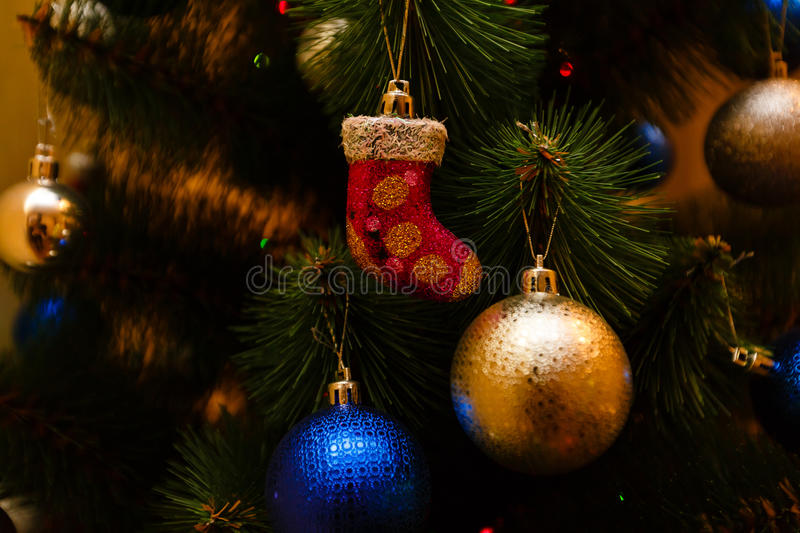 Christmas ornaments on a tree. Decoration traditional stock image