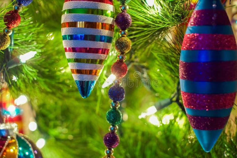 Christmas ornaments on a tree stock photos