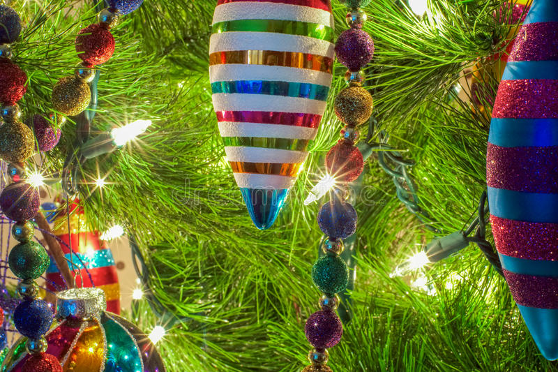 Christmas ornaments on a tree stock images