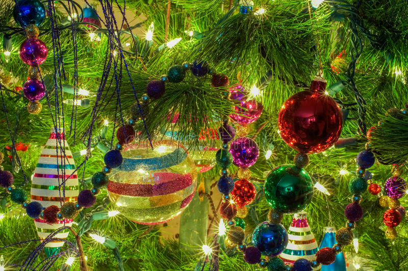 Christmas ornaments on a tree royalty free stock photo
