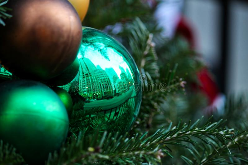 Christmas ornaments on tree in downtown Chicago with reflected cityscape stock photo