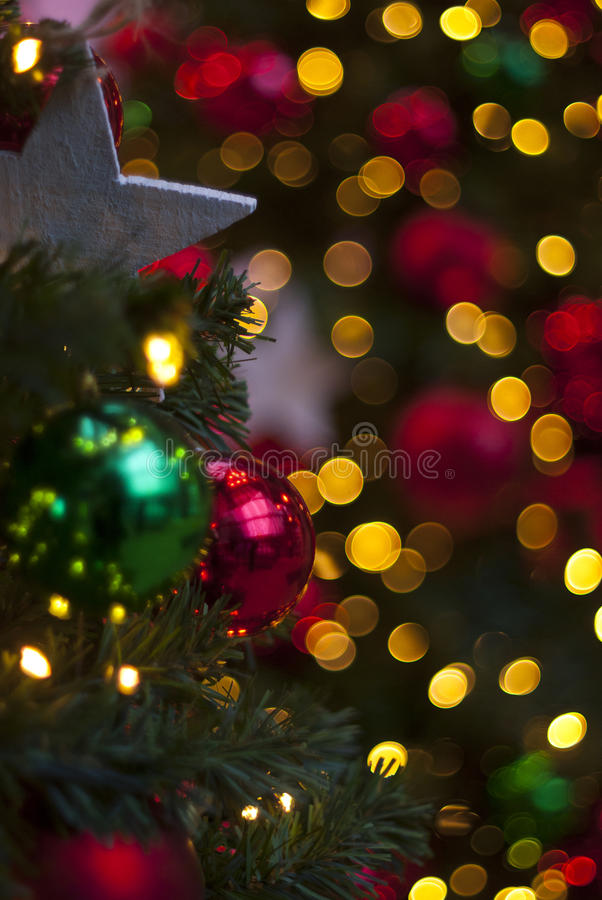 Christmas ornaments in a tree royalty free stock image
