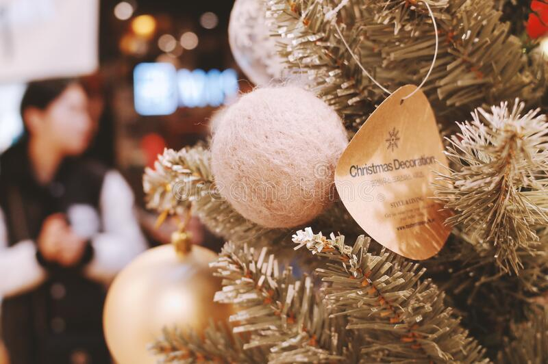 Christmas ornaments on tree in store royalty free stock photos