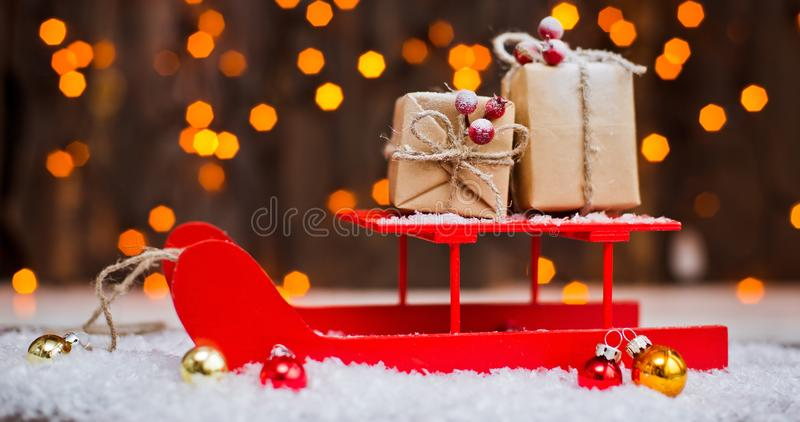 Christmas ornaments of your congratulations. The deer in the sled harness New Year`s gifts packing kraft. stock photo