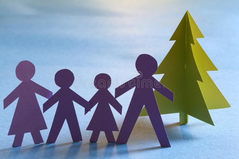 Christmas paper tree and family. Abstract unique concept stock photos