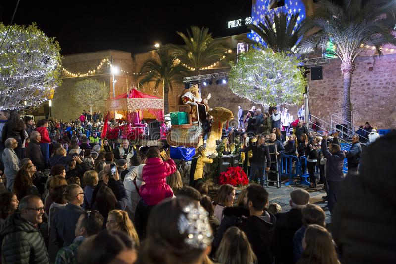 Christmas Parade in Santa Pola, Spain. Santa Pola/Spain - Januari 5 2018: Christmas Parade `Three Kings Parade` along the streets in the city with thousands of stock photography