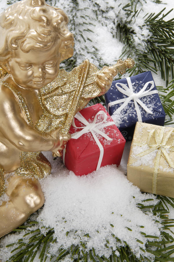 Christmas parcels and Christmas angel, close up royalty free stock image