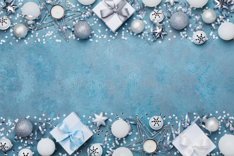 Christmas party banner or background with silver balls, gift, confetti, star and sequins. Flat lay. Copy space for greeting text. stock photo