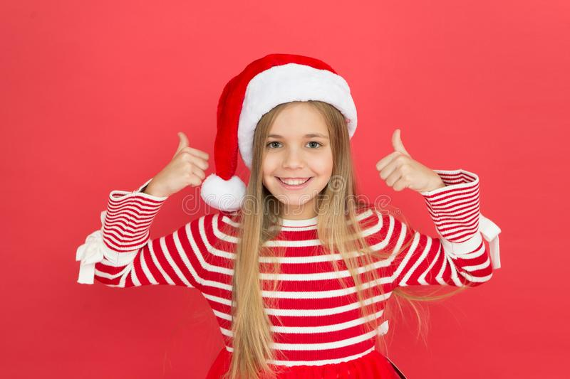 Christmas party. Cheerful girl having fun christmas eve. Best wishes. Joyful kid. Child santa costume believe in miracle royalty free stock photo
