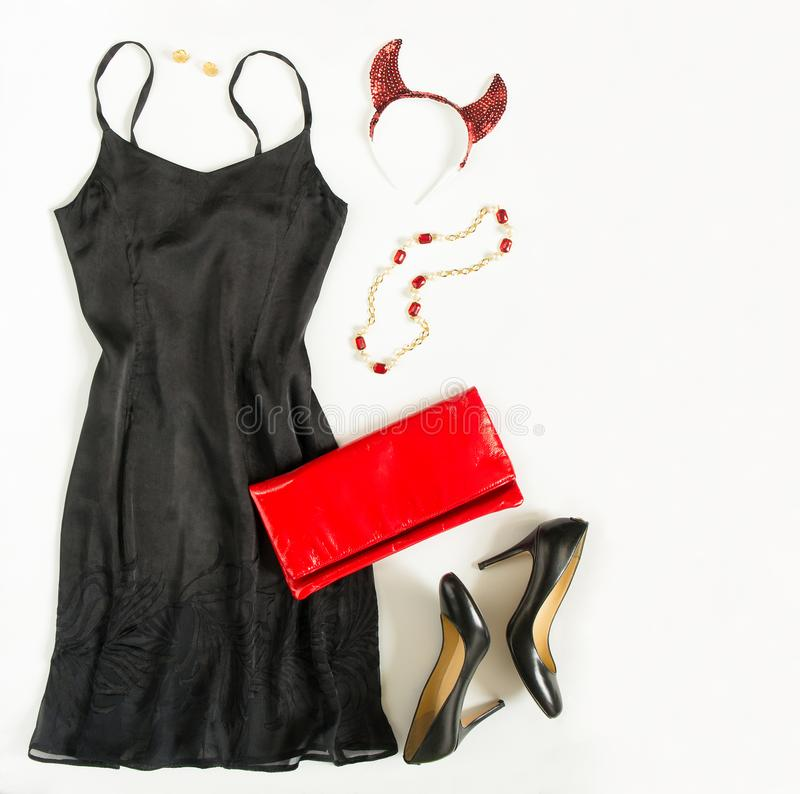 Christmas party outfit. Cocktail dress outfit, night out look on white background. Little black dress, red evening clutch , black. Christmas party outfi royalty free stock images
