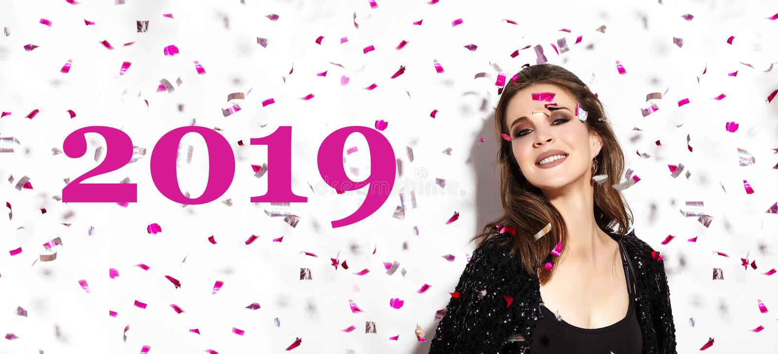 Christmas Party Time. Beautiful Happy Woman Smile. Style in Confetti. New Year 2019 Celebrate Look with Fashion Make-up royalty free stock photos