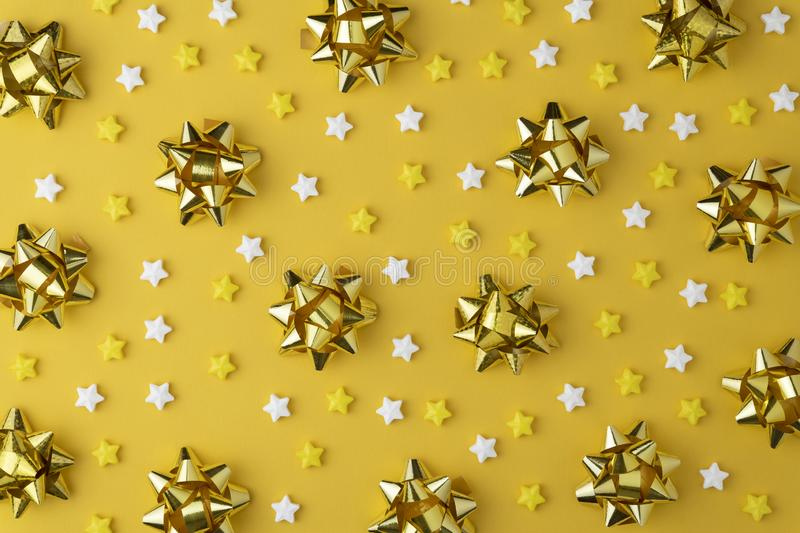 Christmas pattern with Lollipops sweets. Candy flat lay on yellow pastel background. stock images