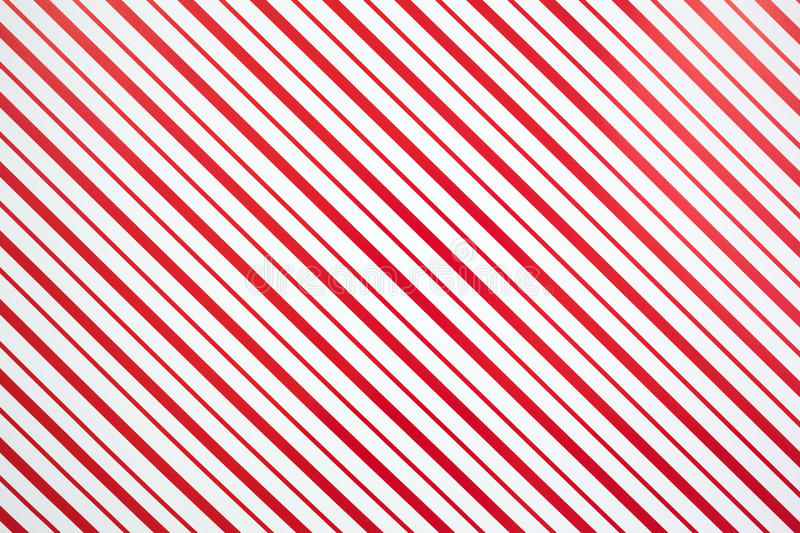 Christmas pattern. A red and white striped Christmas pattern royalty free stock image