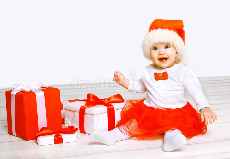 Christmas and people concept - happy baby with gifts. On a white background stock images