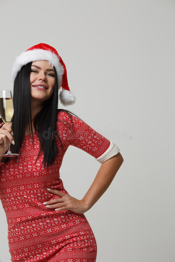 Christmas photo of beautiful woman. With champagne isolated on blank background royalty free stock photos