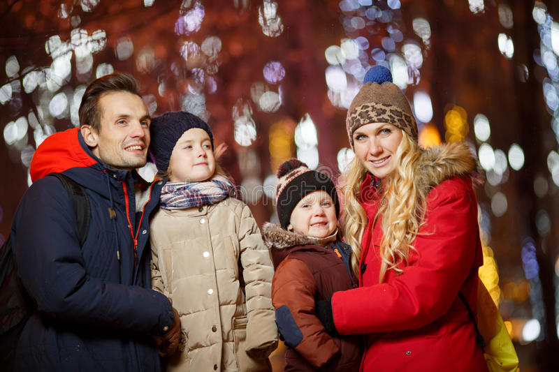 Christmas photo of fun family. Photos on street in evening royalty free stock photo