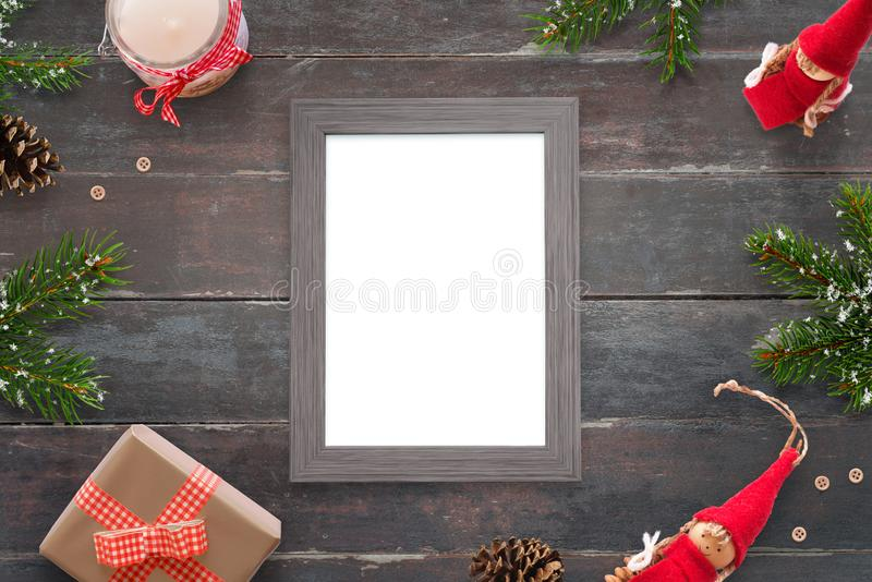 Christmas picture frame for photo or greeting text mockup. Top view scene on wooden table. Gifts and tree bee royalty free stock image