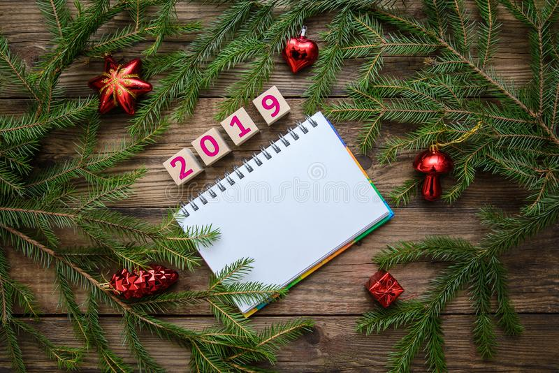 Christmas picture: 2019 new year with fir branches on wooden background royalty free stock images