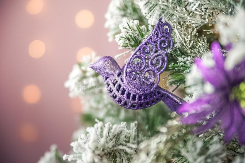 Christmas picture in pink, purple, neon color close up. Scandinavian style of decorating the Christmas tree. Christmas toys such a. S birds, flowers, garlands stock photography