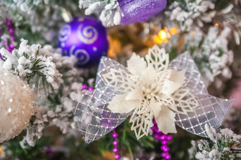 Christmas picture in pink, purple, neon color close up. Scandinavian style of decorating the Christmas tree. Christmas toys such a. S birds, flowers, garlands stock photo