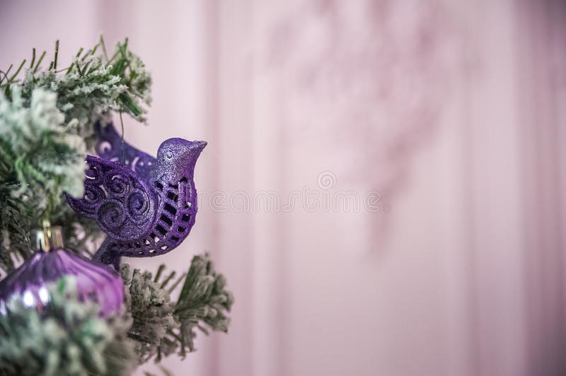 Christmas picture in pink, purple, neon color close up. Scandinavian style of decorating the Christmas tree. Christmas toys such a. S birds, flowers, garlands stock image