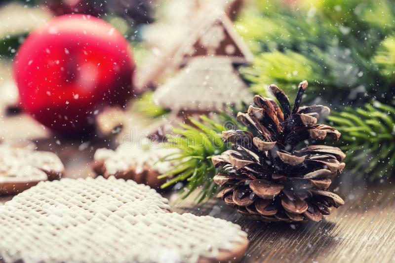 Christmas. Pine cone christmas ball pastry and decoration in snowy atmosphere stock photography