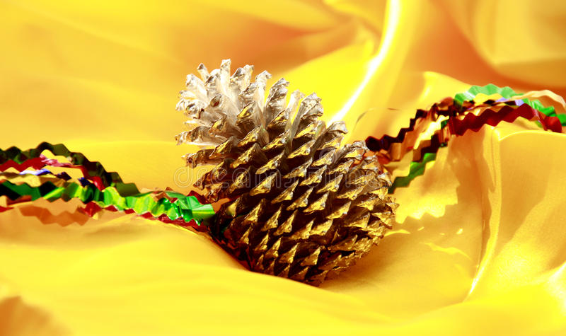 Christmas pine cone decorate on yellow royalty free stock photos