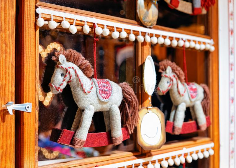 Christmas pony toys at Christmas Market at Town Hall in Winter Berlin, Germany. Advent Fair and Stalls with Crafts Items on the. Bazaar royalty free stock photography