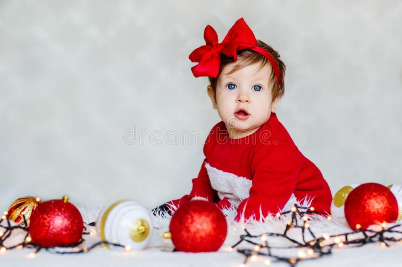 Christmas portrait of adorable baby Santa`s helper. On a white background royalty free stock photos